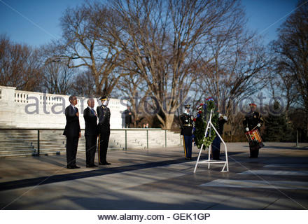 U.S. President Barack Obama and Vice President Joe Biden are pictured as they listen to taps being played after - Stock Photo