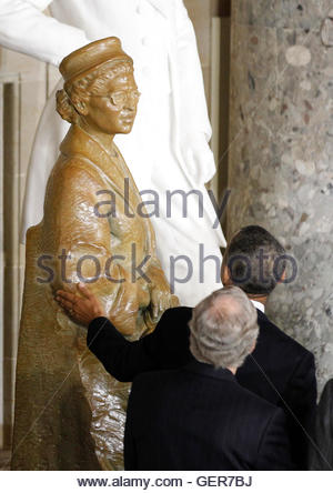 U.S. President Barack Obama reaches out to touch a statue in honor of civil rights activist Rosa Parks, at its unveiling - Stock Photo