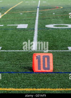 Ten yard line marker on football field - Stock Photo