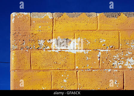 Roof of yellow old building against blue sky - Stock Photo