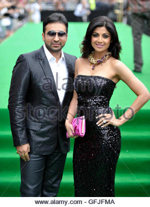 Bollywood actress Shilpa Shetty and husband Raj Kundra arrive on the green carpet during the International Indian - Stock Photo