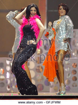 Bollywood actress Shilpa Shetty (L) dances during the International Indian Film Academy (IIFA) show in Toronto June - Stock Photo