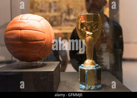 London, UK.  31 July 2016.  The actual match ball and duplicate Jules Rimet trophy on display for one day only at - Stock Photo