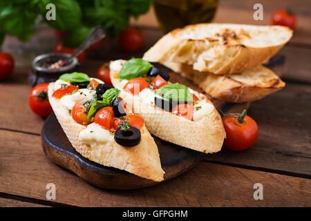 Bruschetta with tomatoes, mozzarella and basil Stock Photo ...
