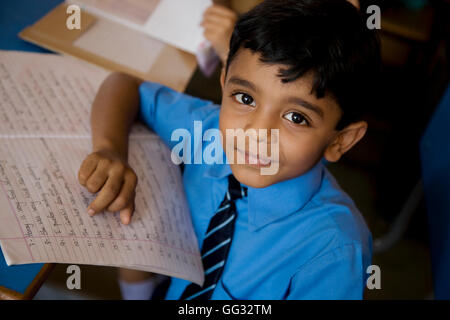 School boy with his notebook - Stock Photo