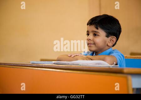 School boy at his desk - Stock Photo