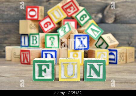 Fun word on wooden table - Stock Photo