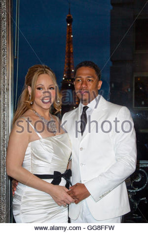 Musician Mariah Carey and husband Nick Cannon attend a photo call near the Eiffel Tower before their vow renewal - Stock Photo