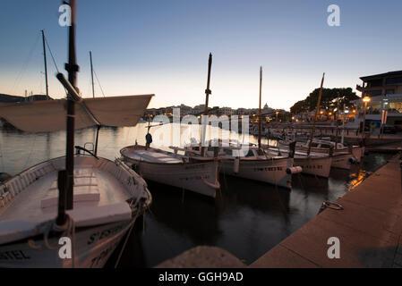 Llauts or Mallorcan fishing boats in the port of Cala Ratjada at the jetty, Cala Ratjada, Mallorca, Balearic Islands, - Stock Photo