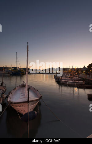 Llauts or Mallorcan fishing boats in the port of Cala Ratjada at the jetty, Cala Ratjada, Mallorca, Balearic Islands, - Stock Photo