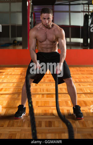 Battling Ropes Young Man At Gym Workout Exercise - Stock Photo