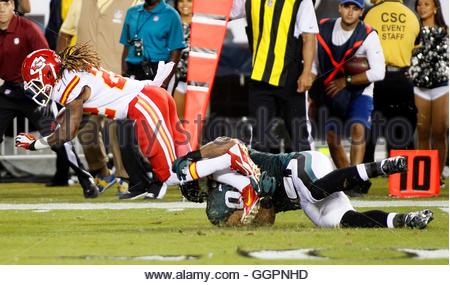 Kansas City Chiefs' Dexter McCluster (L) is pulled down Philadelphia Eagles Josh Martin (95) inside the ten-yard - Stock Photo