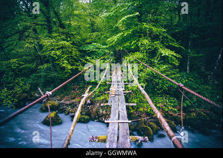 Wooden Bridge old over river beautiful Landscape - Stock Photo