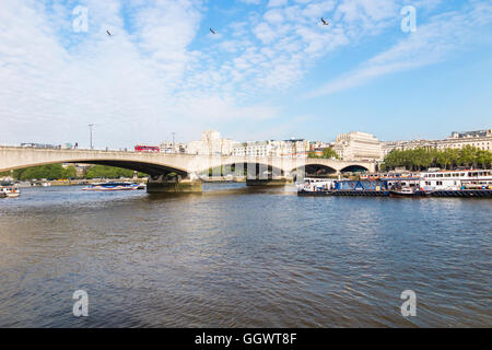 Waterloo Bridge over the River Thames, London, UK, Shell-Mex House in the background on a sunny day with blue sky - Stock Photo