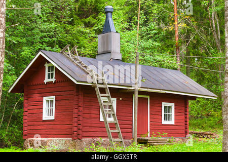 old small red wooden sauna cabin by a lake finland stock photo 21098325 alamy. Black Bedroom Furniture Sets. Home Design Ideas