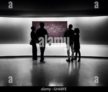 Silhouette of Two Heterosexual Couples Evaluating a Piece of Abstract Wall Art, Solomon R. Guggenheim Museum, New - Stock Photo