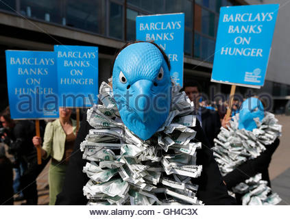A demonstrator protests against market speculation on food commodities outside the Barclays Bank Annual General - Stock Photo