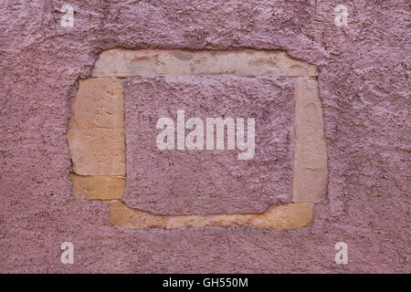 Burgundy red painted stucco wall. - Stock Photo