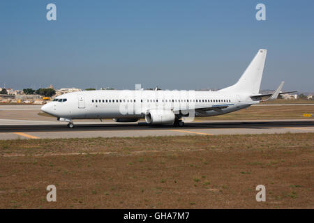 Commercial jet plane taxiing for departure. Proprietary details deleted and no faces visible. - Stock Photo