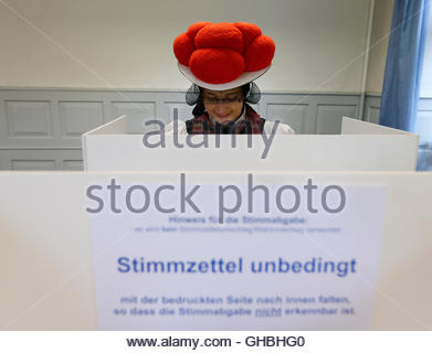 Gerlinde Moser wearing a traditional Black Forest costume fills her ballot in the general election (Bundestagswahl) - Stock Photo