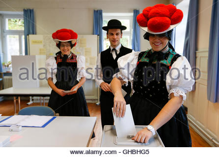 Corinna Woehrle (R) and her brother Christoph with Gerlinde Moser (L) wearing traditional Black Forest costumes - Stock Photo