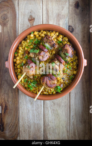 Chicken and chorizo skewers with paella-style rice - Stock Photo