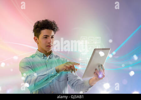 Young man using digital tablet - Stock Photo