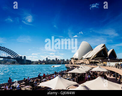 sydney opera house famous landmark and waterside cafe restaurant promenade in australia - Stock Photo