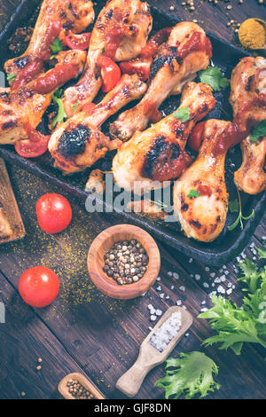 Chicken drumsticks on pan and spice - Stock Photo