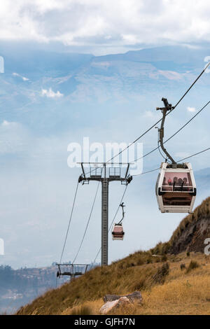 Running from the edge of Quito up the east side of Pichincha mountain, the Teleférico is one of the highest aerial - Stock Photo