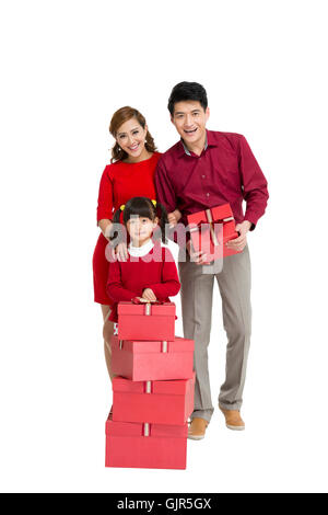 Studio shot a family of three and gift boxes - Stock Photo