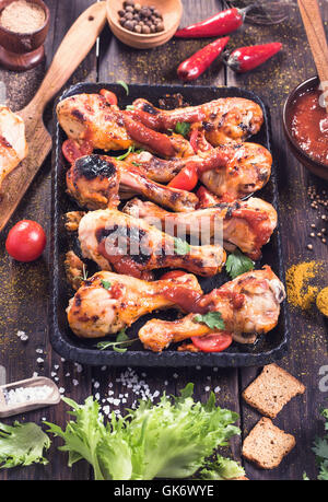 Drumsticks on serving pan - Stock Photo