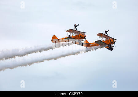 Bournemouth, UK. 21 Aug, 2016. Breitling wingwalkers perform at the Bournemouth Air Festival, Bournemouth, UK Credit: - Stock Photo