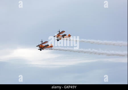 Bournemouth, UK. 21 August 2016. Breitling wingwalkers perform at the Bournemouth Air Festival, Bournemouth, UK - Stock Photo