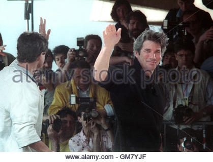 American actor Richard Gere smile as he waves good-bye to the press from the terrace of the festival palace in Cannes - Stock Photo