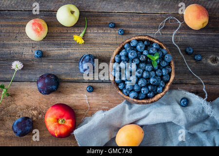 Fresh fruits on a wooden table. Top view - Stock Photo