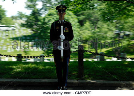 An honor guard member stands at attention as the motorcade of US President George W. Bush passes by, after Memorial - Stock Photo