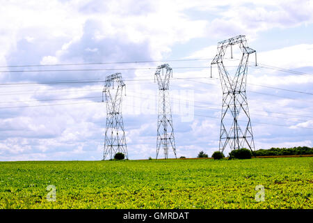 High Power electricity pylons crossing countryside in France - Stock Photo