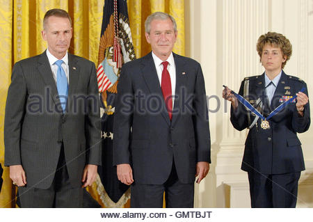 Retired US.. Marine Corps General Peter Pace (L), former chairman of the Joint Chiefs of Staff, stands to receive - Stock Photo