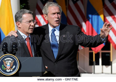 President of Colombia Alvaro Uribe (L) stands with US President George W. Bush (R) during a joint statement in the - Stock Photo