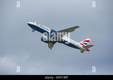 British Airways Airbus A320-232on runway at Inverness Airfield about to take off.  SCO11,223. - Stock Photo