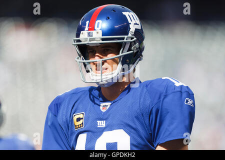 Oct 16, 2011; East Rutherford, NJ, USA; New York Giants quarterback Eli Manning (10) warms up before the game against - Stock Photo