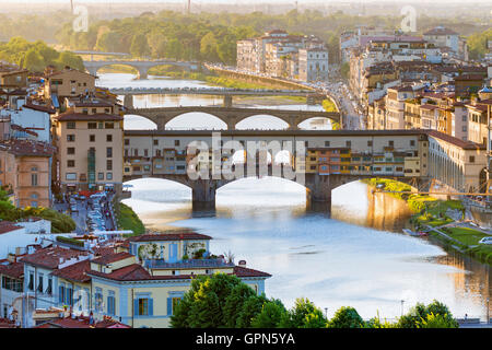 Ponte vecchio bridge at sunset in Florence in Italy - Stock Photo