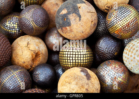 Various decorative wooden and metallic balls in a flea market - Stock Photo