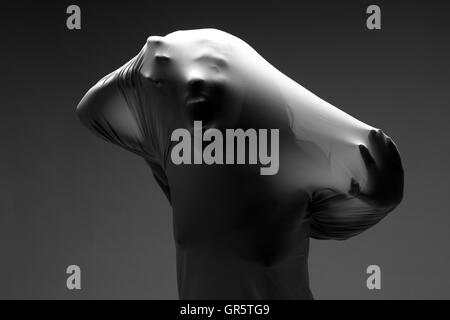 Scary Horror Image of a Woman Trapped in Fabric - Stock Photo