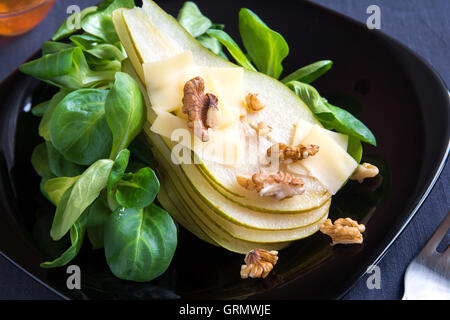 Pear salad with parmesan cheese and walnuts - Stock Photo
