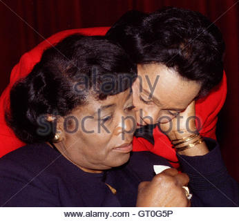 Betty Shabazz (L) wife of slain civil rights leader Malcolm X is embraced by Coretta Scott King (R) wife of Martin - Stock Photo