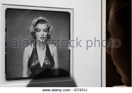 A visitor looks at the picture 'Marilyn Monroe, Actress, New York City, May 6, 1957' by photographer Richard Avedon - Stock Photo