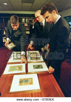 Germany's Consul General in Boston Dr. P. Christian Hauswedell (C) looks over seven stolen masterpieces before they - Stock Photo