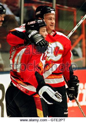 The Calgary Flames Theoren Fluery (L) is hugged by teammate German Titov after Fleury's goal in the first period - Stock Photo